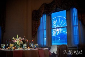 Interior of Candlelight ballroom with view of Ferris wheel at night from window