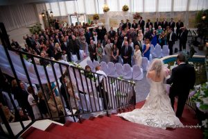 Bride Walking down the stairs in the Garden Room