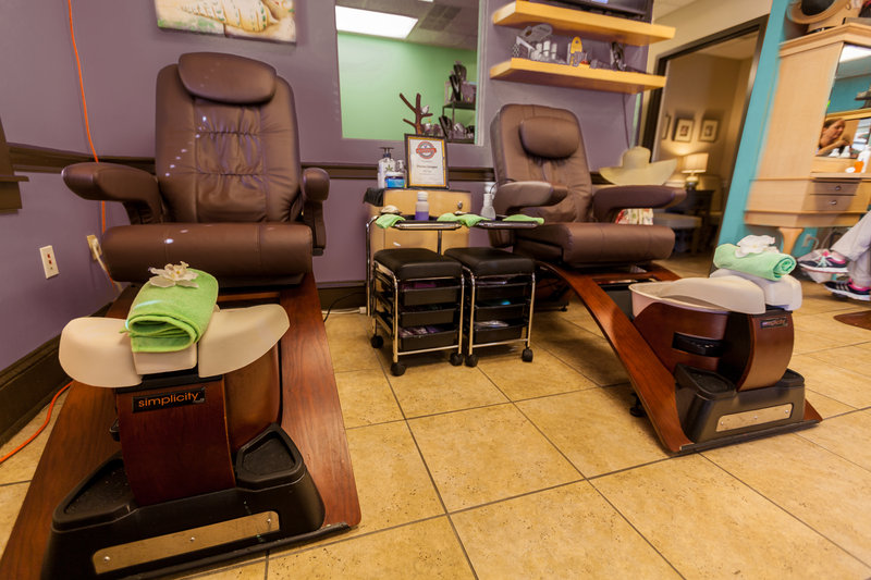 Interior of Divine Images Salon and Day Spa. Pedicure chairs.