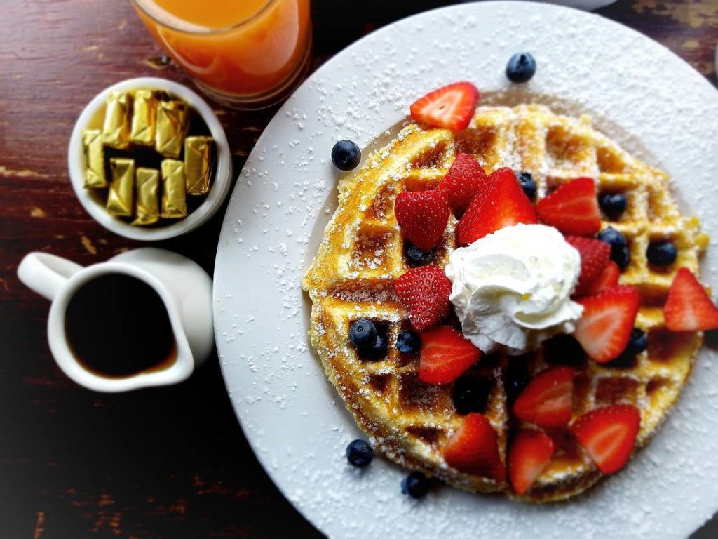 Photo: Belgian Waffle topped with fruit and whipped cream