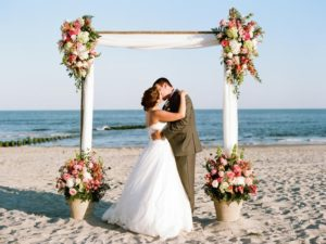 Bridge and Groom kissing on the beach