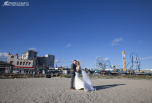 A bride and groom hugging on the beach