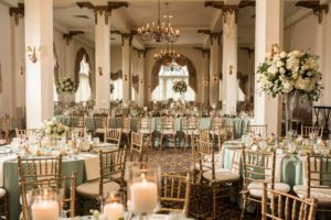 interior of candlelight ballroom, green and gold decor
