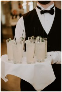 A server holding cocktails