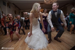 bride and groom dancing in crystal ballroom