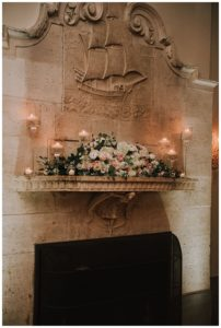 Mantle over fireplace in the promenade