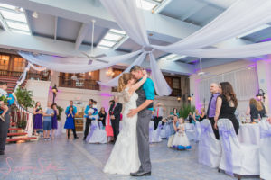 bride and groom dancing in the garden room