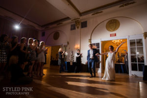 bride and groom arriving in the crystal ballroom