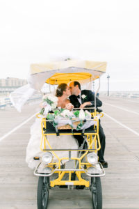 Bride and Groom Kissing on a Surrey on the boardwalk
