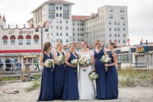 Bridal party on the beach; bridesmaids in blue