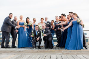 Wedding party celebrating on the boardwalk
