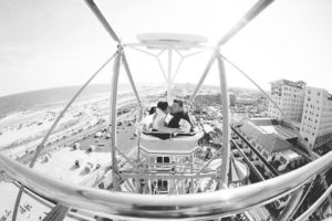 Black and white photo of couple on ferris wheel